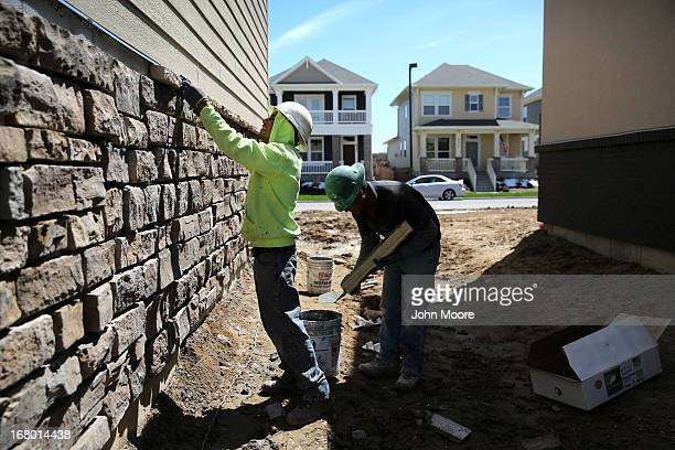 Mexican immigrants work on a housing development on May 3 2013 in Denver Colorado The resurgent housing market has helped drive down unemployment...