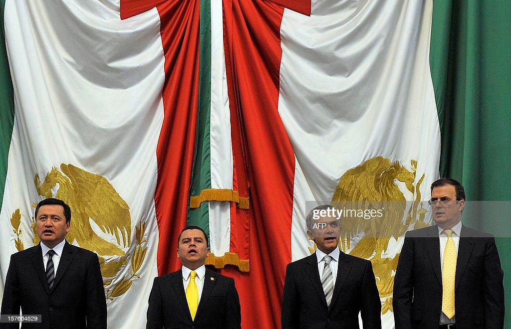 Mexican Interior Minister Miguel Osorio Chong, local congressman Manuel Granados Covarrubias, Mexico City new Mayor Miguel Angel Mancera, and outgoing mayor Marcelo Ebrard at the Local Congress in Mexico City, on December 5, 2012. AFP PHOTO/Guillermo Ogam