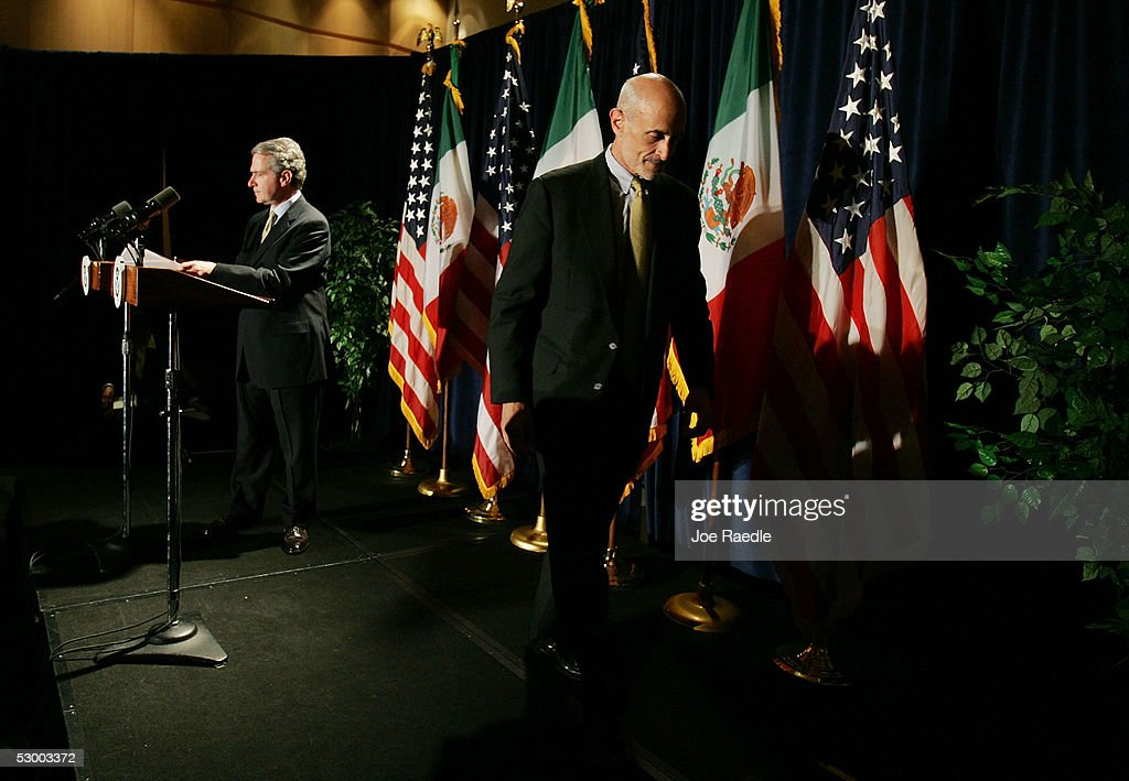 Mexican Interior Minister Santiago Creel and US Secretary of Homeland Security Michael Chertoff leave the podium after a news conference May 31 2005...