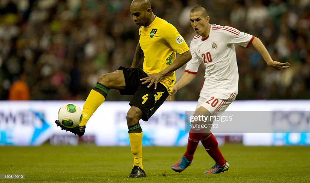 Mexican Jorge Torres (R) disputes the ball with Jamaica's Marvin Elliott (L) during their their Brazil-2014 FIFA World Cup CONCACAF football qualifier match against Jamaica at the Azteca stadium in Mexico City, on February 6, 2013.