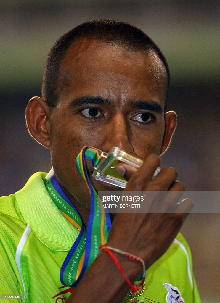 Mexican Jose Galvan kisses the gold medal won in the men's 10000m at the XV Pan - mexican-jose-galvan-kisses-the-gold-medal-won-in-the-mens-10000m-at-picture-id75830180