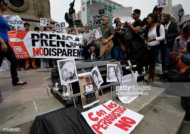 Mexican journalists and students of journalism take part in a demo against violence to journalists at the Angel de la Independencia monument in...