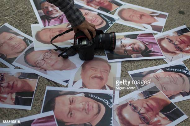 Mexican journalists place portraits of their murdered colleagues during a demonstration to draw attention to the latest wave of killings of...