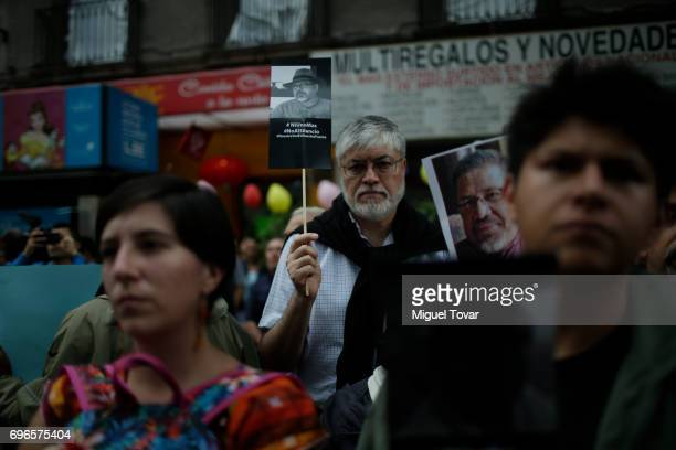 Mexican journalists protest during a demonstration to end violence against journalists in Mexico outside the Palacio de Bellas Artes on June 15 2017...