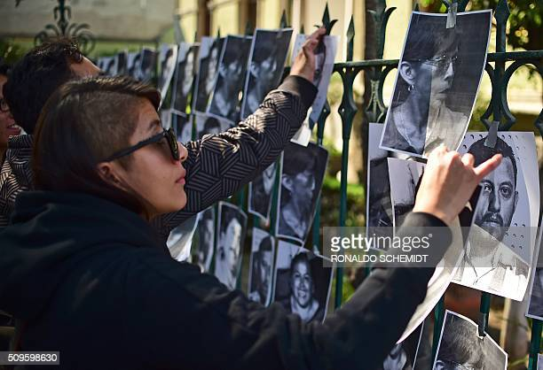 Mexican journalists stick photos of killed journalists on the fence of the Veracruz state representation office during a protest in Mexico City on...