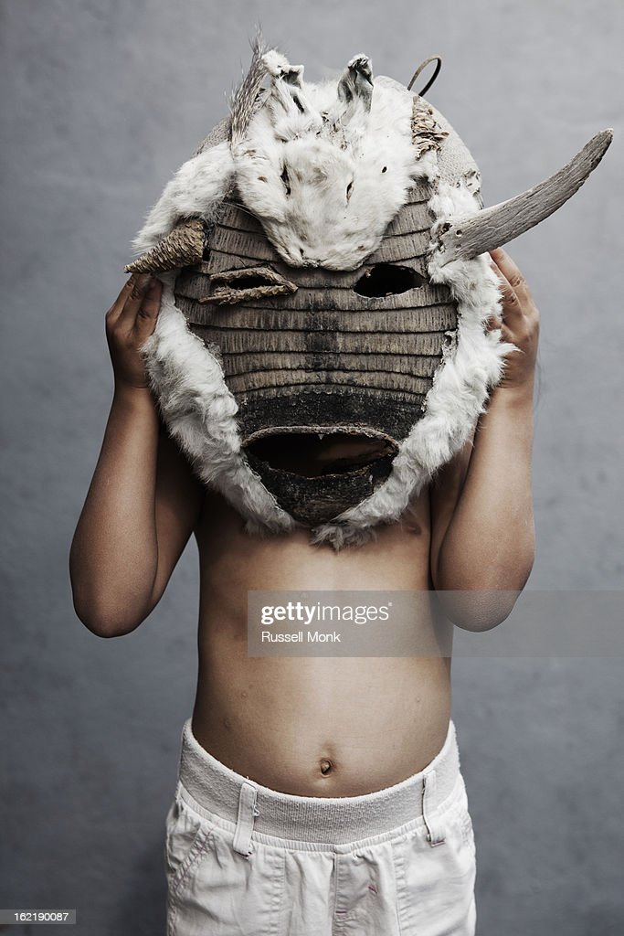 Mexican kid holding a furry mask. : Stock Photo