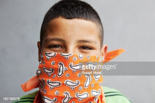 Mexican kid wearing a handkerchief over his mouth. : Stockfoto