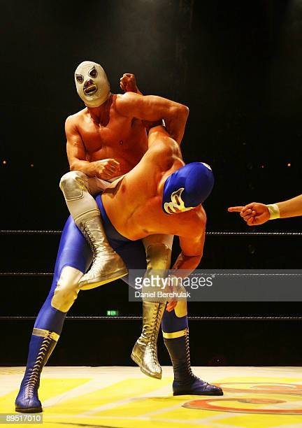 Mexican Lucha Libre Wrestler El Hijo Del Santo competes against Blue Demon Jr at the Roundhouse in Camden on July 5 2008 in London England