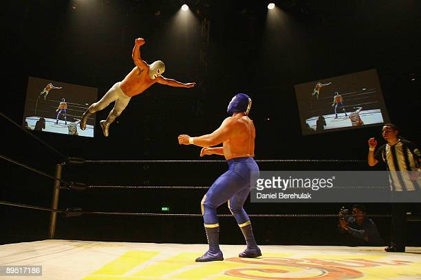Mexican Lucha Libre Wrestler El Hijo Del Santo performs one of his signature moves against Blue Demon Jr at the Roundhouse in Camden on June 5 2008...