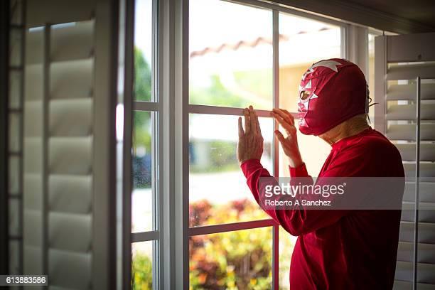 Mexican luchador looking thru the windows
