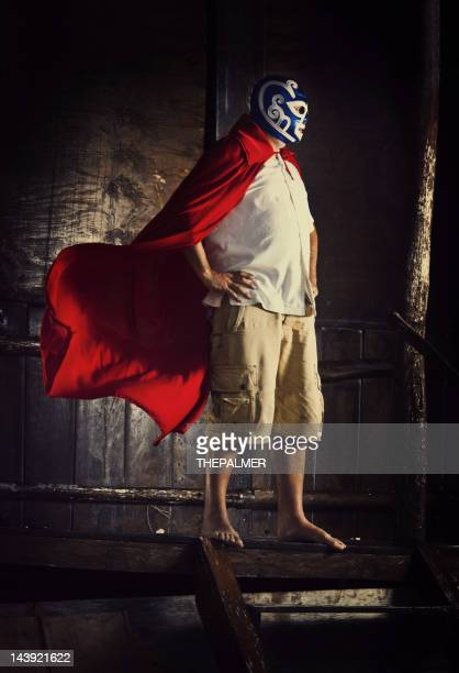 mexican luchador standing in front of a beach cabana