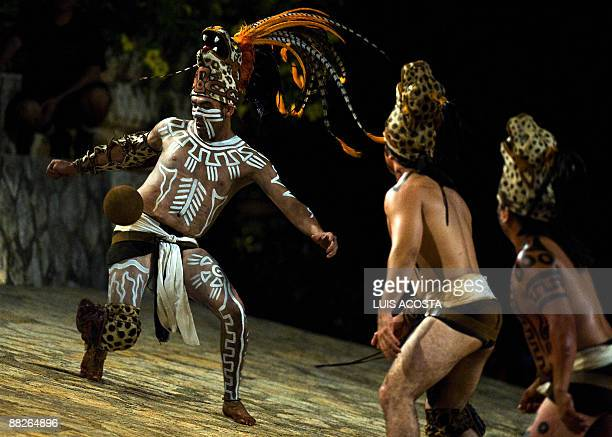 A Mexican man in prehispanic Aztec costume play the ball during a traditional 'Juego de Pelota' at the Xcaret ecopark in Xcaret Mexico on June 5...