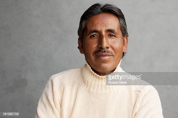 A Mexican man wearing a sweater