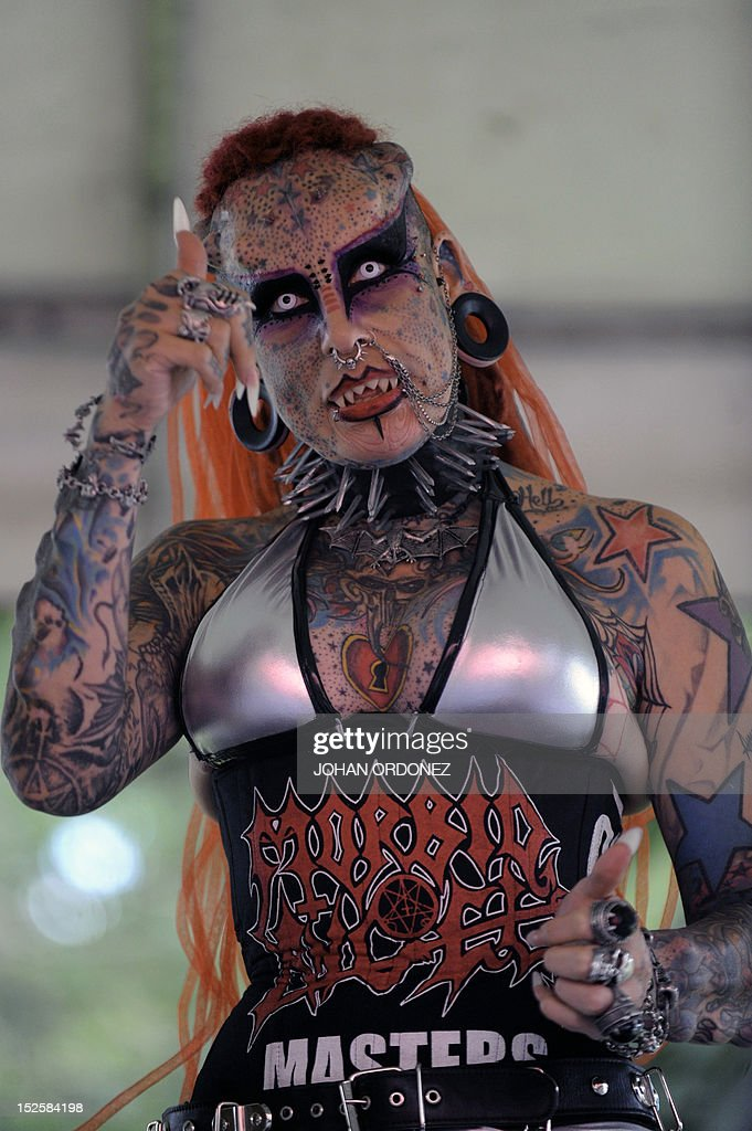 Mexican Maria Jose Cristerna, known as 'Vampire Woman', Guinness World Record for being the woman with more changes in her body in America, gestures at La Aurora Zoo, during the Latin American Extreme Unity Fest in Guatemala City on September 22, 2012. AFP PHOTO / Johan ORDONEZ