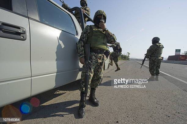 Mexican marines keep a checkpoint at the Cuatro Caminos road in Apatzingan Michoacan State Mexico on December 12 2010 Gunmen from La Familia cartel...