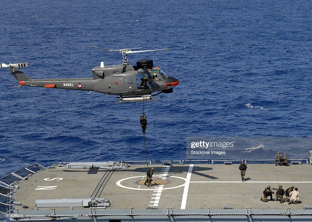 Mexican Military Commandos rappel onto a German combat support ship.