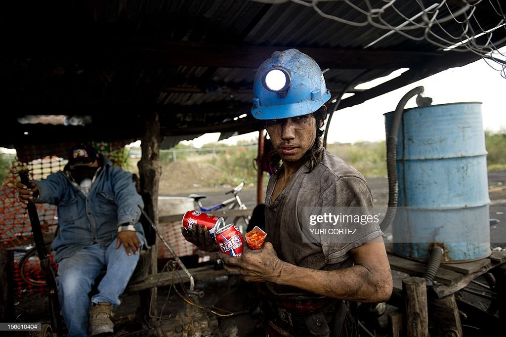 A Mexican miner carries a snack and sodas to go down to into a shaft to work in a coal mine in Agujita, Coahuila State in Mexico on November 13, 2012. According to the Mining Chamber of Mexico, the country produces annually 15 million tons of coal, with an average annual production worth USD 3,800 million, representing 1.6% of the country's Gross Domestic Product (GDP) . The bulk of the coal is used for power generation and steel production. Recent press reports affirm that drugs cartel are involved in the coal-related activities.