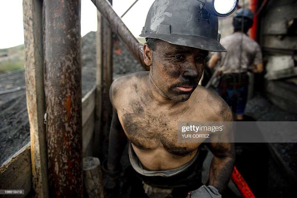 A Mexican miner emerges from a shaft in a coal mine in Agujita, Coahuila State in Mexico on November 13, 2012. According to the Mining Chamber of Mexico, the country produces annually 15 million tons of coal, with an average annual production worth USD 3,800 million, representing 1.6% of the country's Gross Domestic Product (GDP) . The bulk of the coal is used for power generation and steel production. Recent press reports affirm that drugs cartel are involved in the coal-related activities.