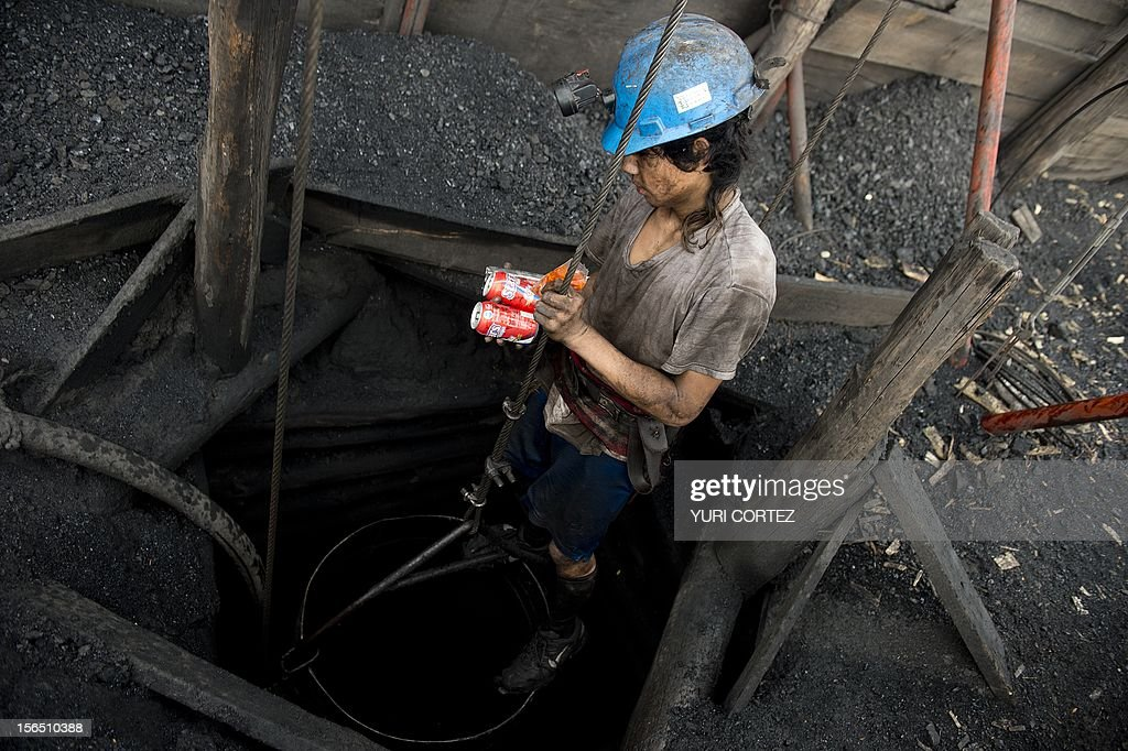 A Mexican miner goes down into a shaft in a coal mine in Agujita, Coahuila State in Mexico on November 13, 2012. According to the Mining Chamber of Mexico, the country produces annually 15 million tons of coal, with an average annual production worth USD 3,800 million, representing 1.6% of the country's Gross Domestic Product (GDP) . The bulk of the coal is used for power generation and steel production. Recent press reports affirm that drugs cartel are involved in the coal-related activities.