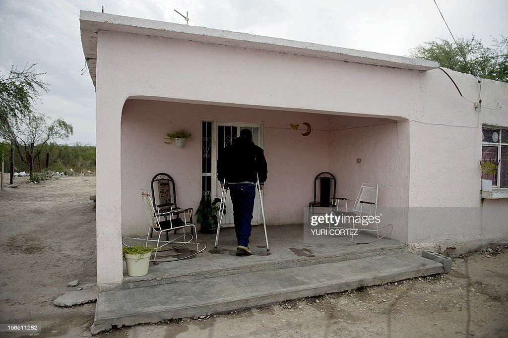 Mexican miner Rosalio Ayala (48) who lost one of his feet during an accident when he was working in a coal shaft, arrives at home in Barroteran, Coahuila State in Mexico on November 13, 2012. According to the Mining Chamber of Mexico, the country produces annually 15 million tons of coal, with an average annual production worth USD 3,800 million, representing 1.6% of the country's Gross Domestic Product (GDP) . The bulk of the coal is used for power generation and steel production. Recent press reports affirm that drugs cartel are involved in the coal-related activities.