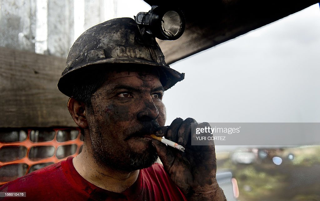 A Mexican miner smokes after exiting a shaft in a coal mine in Agujita, Coahuila State in Mexico on November 13, 2012. According to the Mining Chamber of Mexico, the country produces annually 15 million tons of coal, with an average annual production worth USD 3,800 million, representing 1.6% of the country's Gross Domestic Product (GDP) . The bulk of the coal is used for power generation and steel production. Recent press reports affirm that drugs cartel are involved in the coal-related activities.