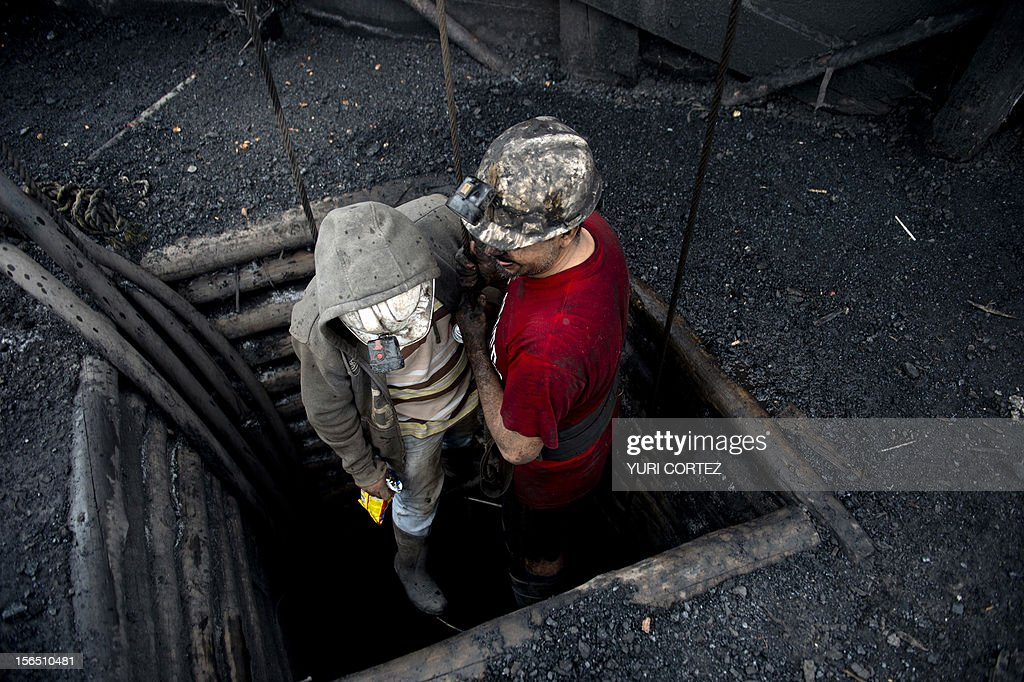 Mexican miners go down in a shaft of a coal mine in Agujita, Coahuila State in Mexico on November 13, 2012. According to the Mining Chamber of Mexico, the country produces annually 15 million tons of coal, with an average annual production worth USD 3,800 million, representing 1.6% of the country's Gross Domestic Product (GDP) . The bulk of the coal is used for power generation and steel production. Recent press reports affirm that drugs cartel are involved in the coal-related activities.