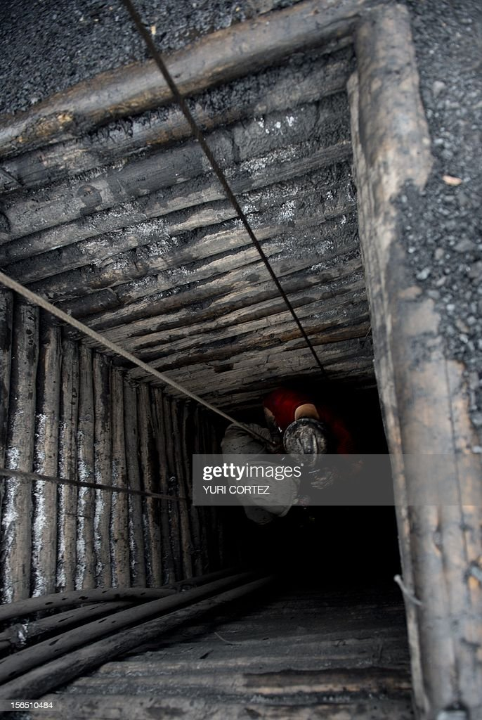 Mexican miners go down in a shaft of a coal mine in Agujita, Coahuila State in Mexico on November 13, 2012. According to the Mining Chamber of Mexico, the country produces annually 15 million tons of coal, with an average annual production worth USD 3,800 million, representing 1.6% of the country's Gross Domestic Product (GDP) . The bulk of the coal is used for power generation and steel production. Recent press reports affirm that drugs cartel are involved in the coal-related activities. AFP PHOTO/YURI CORTEZ