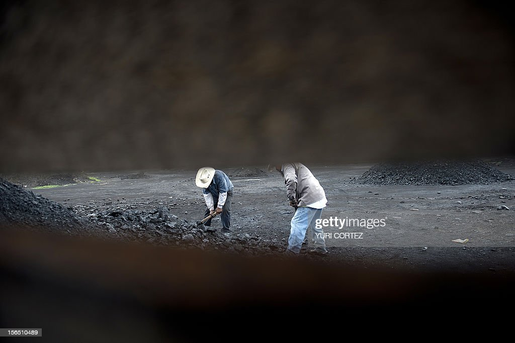 Mexican miners select and break coal extracted from a mine in Agujita, Coahuila State in Mexico on November 13, 2012. According to the Mining Chamber of Mexico, the country produces annually 15 million tons of coal, with an average annual production worth USD 3,800 million, representing 1.6% of the country's Gross Domestic Product (GDP) . The bulk of the coal is used for power generation and steel production. Recent press reports affirm that drugs cartel are involved in the coal-related activities.