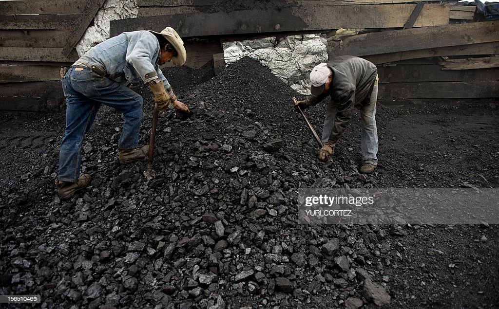 Mexican miners select coal extracted from a mine in Agujita, Coahuila State in Mexico on November 13, 2012. According to the Mining Chamber of Mexico, the country produces annually 15 million tons of coal, with an average annual production worth USD 3,800 million, representing 1.6% of the country's Gross Domestic Product (GDP) . The bulk of the coal is used for power generation and steel production. Recent press reports affirm that drugs cartel are involved in the coal-related activities. AFP PHOTO/YURI CORTEZ