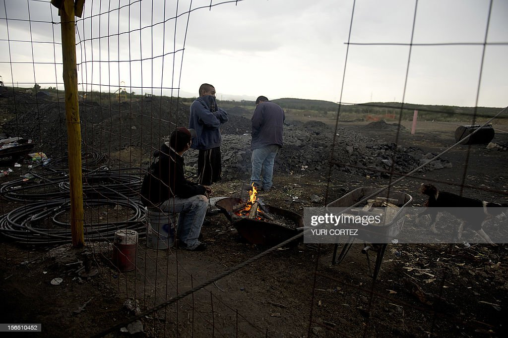 Mexican miners warm up around a bonfire before getting into a shaft in a coal mine in Agujita, Coahuila State in Mexico on November 13, 2012. According to the Mining Chamber of Mexico, the country produces annually 15 million tons of coal, with an average annual production worth USD 3,800 million, representing 1.6% of the country's Gross Domestic Product (GDP) . The bulk of the coal is used for power generation and steel production. Recent press reports affirm that drugs cartel are involved in the coal-related activities.