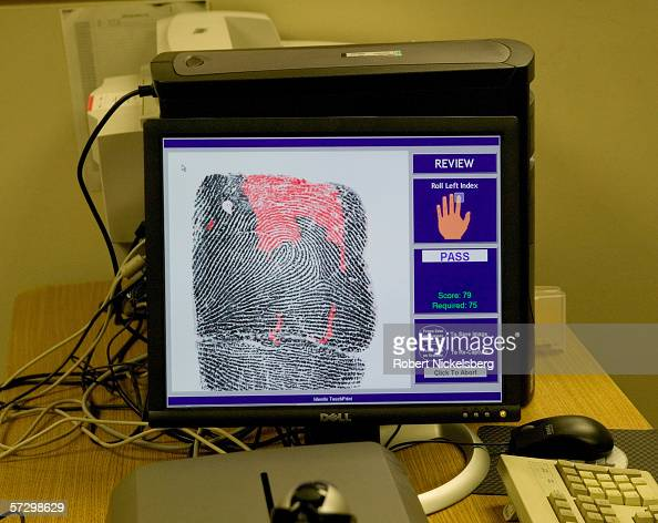 A Mexican national and US resident alien Nicolas NeriJorge 57 years is electronically fingerprinted by US Immigration and Customs Enforcement agents...