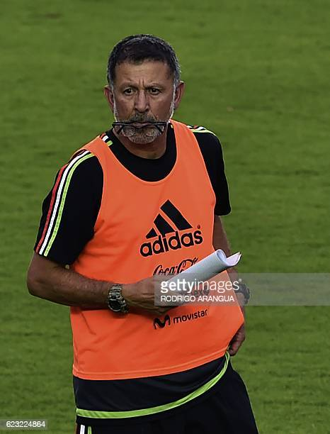 Mexican national football team coach Juan Carlos Ososrio directs a training at the Rommel Fernandez stadium in Panama City on November 14 ahead of a...