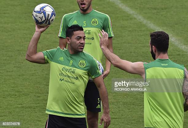 Mexican national football team player Marco Fabian participates in a training at the Rommel Fernandez stadium in Panama City on November 14 ahead of...