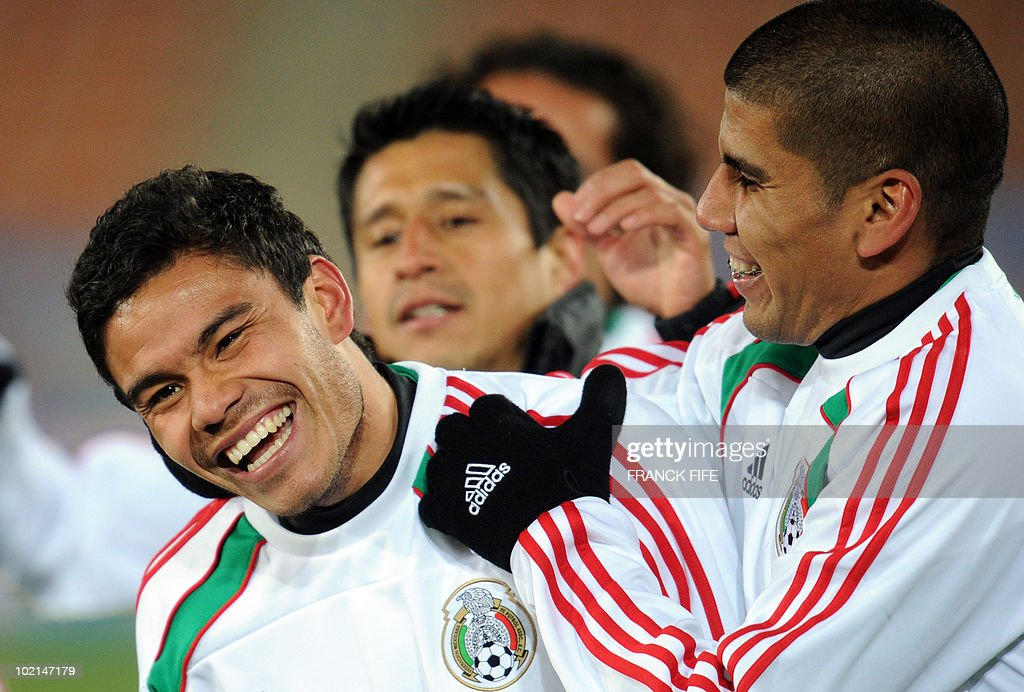 Mexican national footballers Carlos Salcido (R) and Pablo Barrera joke during a training session at Peter Mokaba stadium in Polokwane on June 16, 2010. Mexico will face France on June 17 in a Group A game of the 2010 World Cup 2010.