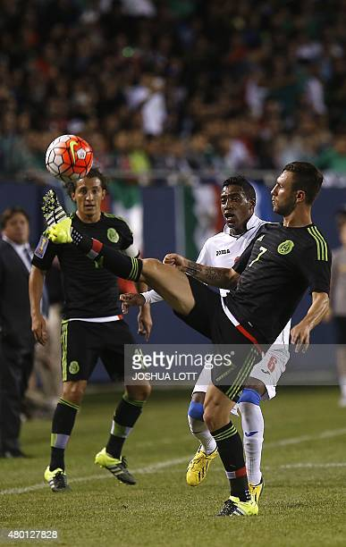 Mexican National Team defender Miguel Layun controls the ball against Cuban National Team defender Yaisnier Napoles during the first half of their...