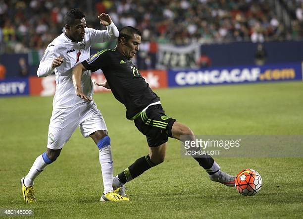 Mexican National Team defender Paul Aguilar controls the ball past Cuban National Team defender Yaisnier Napoles during the second half of their...