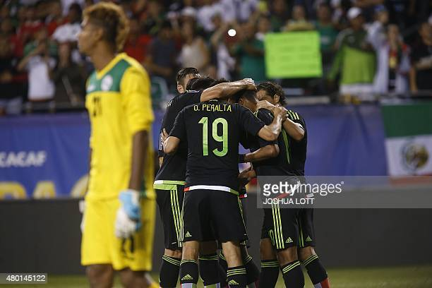 Mexican National Team forward Oribe Peralta celebrates his goal with teammates during the second half of their CONCACAF Gold Cup soccer game against...
