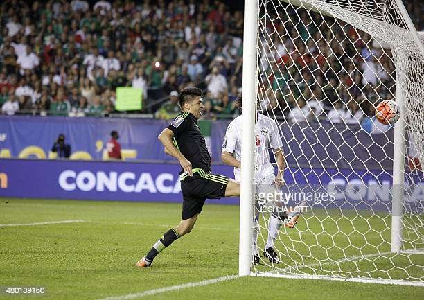 Mexican National Team forward Oribe Peralta scores a goal against the Cuban National Team during the second half of their CONCACAF Gold Cup soccer...