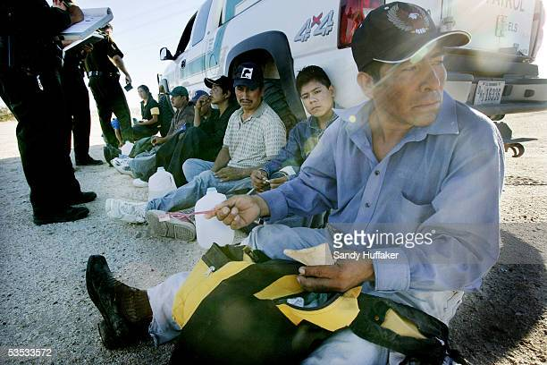 Mexican nationals caught coming over the border await deportation in the desert August 30 2005 near El Centro California The Governors of New Mexico...