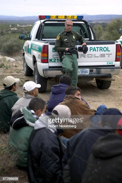 Mexican nationals who illegally crossed the California border are apprehended and handcuffed 1 mile inside US territory by Customs and Border...