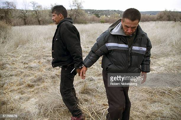 Mexican nationals who illegally crossed the California border are apprehended and handcuffed 3 miles inside US territory by Customs and Border...
