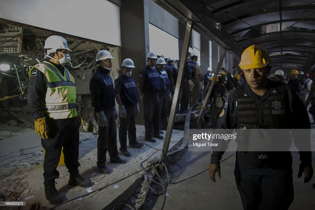 Mexican navy officers inspect the PEMEX administrative building after the explotion on February 01, 2013 in Mexico City, Mexico. Pemex is stepping up security at oil production facilities as authorities investigate a blast that killed at least 33 people at the state-owned company's headquarters in Mexico City.
