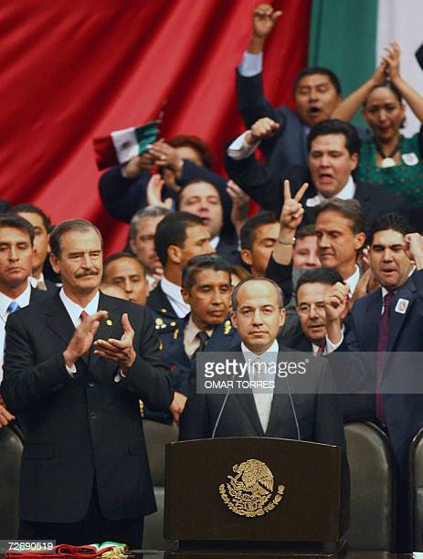 Mexican new President Felipe Calderon is cheered by National Action Party fellows and outgoing President Vicente Fox 01 December 2006 at the Congress...