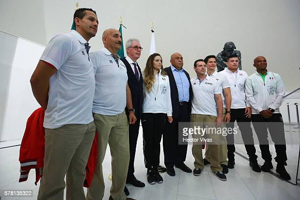 Mexican olympic trainers with Enio Cordeiro Brazilian Ambassador to Mexico pose for pictures during Mexico Olympic Team Farewell Ceremony at Soumaya...