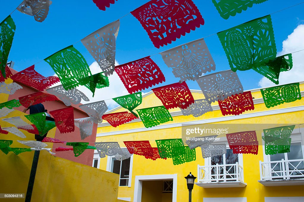 Mexican Papel Picado Decorations Over A Street In San Miguel De Cozumel On Island Near