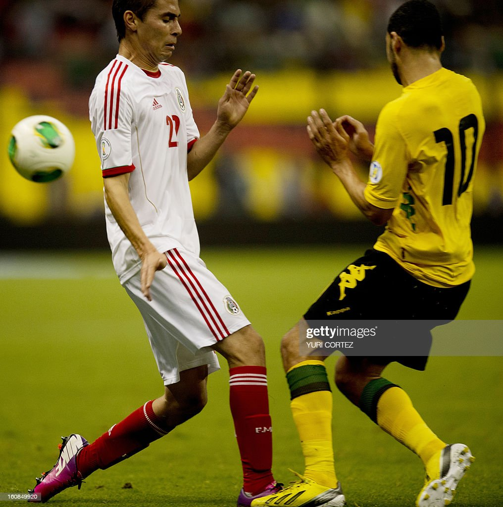 Mexican Paul Aguilar (L) disputes the ball with Jamaica's Joel Mcanuff (R) during their their Brazil-2014 FIFA World Cup CONCACAF football qualifier match against Jamaica at the Azteca stadium in Mexico City, on February 6, 2013. AFP PHOTO/ YURI CORTEZ