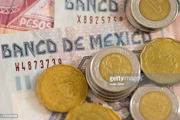 'Mexican pesos, notes and coins, close up'