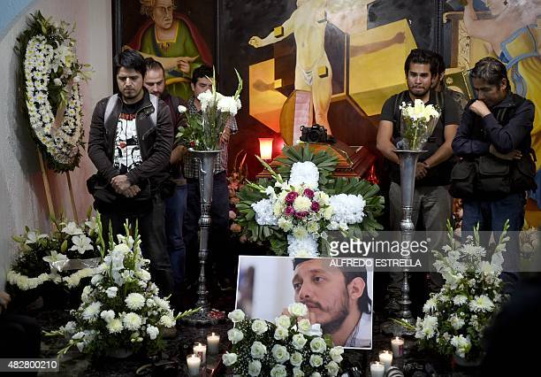 Mexican photojournalists attend the funeral service of their murdered colleague Ruben Espinosa in Mexico City on August 2 2015 Espinosa was found...