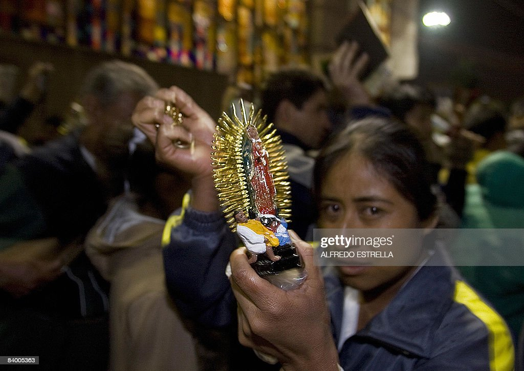 A Mexican pilgrim carries an image of Virgin Guadalupe during annual celebrations for the Patron Saint at the Basilica of Guadalupe on December 11 in...