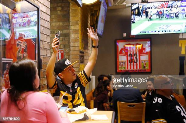 Mexican Pittsburgh Steelers fan cheers after his team scored a touchdown against the Tennessee Titans as fans watch the Steelers game at a Buffalo...